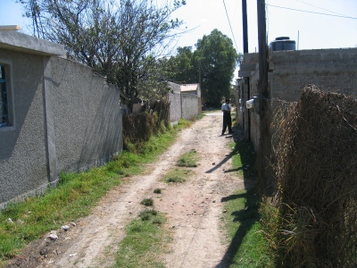 Photo of Elder Hernandez tracting in Mexico.