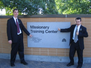 Photo of Elders Willoughby and Campbell by the MTC sign