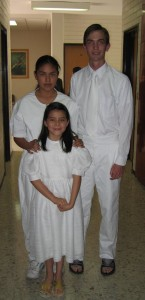 Photo of Elder Willoughby ready to baptize two sisters