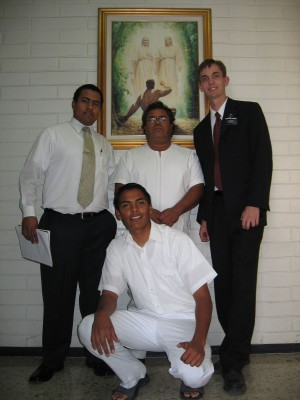 Photo with four men, one ready to be baptized.