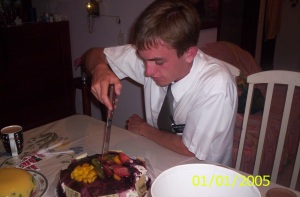 Photo of Elder Willoughby cutting his birthday cake