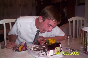 Photo of Elder Willoughby pretending to eat the whole cake