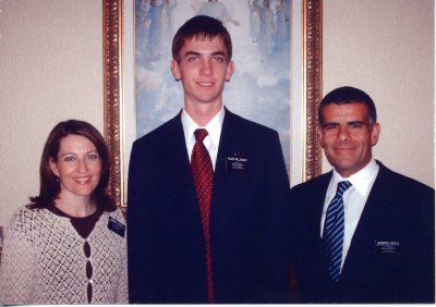 Photo of Mission President and his wife with Jake