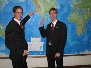 Two elders pointing to mission destinations on MTC map