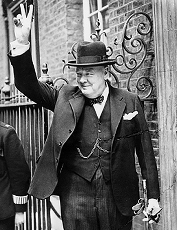 Winston Churchill at Downing Street giving his famous V sign in June 1943
