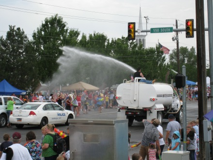 Water trucks hose off pedestrians from city streets