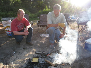 Brett and Bishop Mike Facer cook a meal