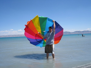 Derek had to run after the beach umbrella when a breeze blew it into the lake.