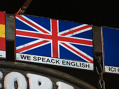 We Speack English sign.