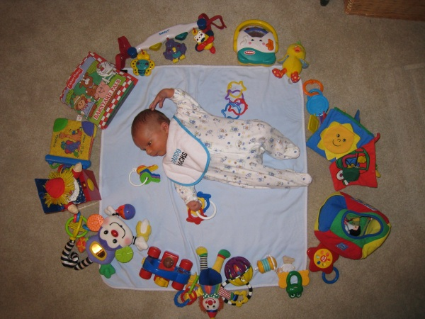 Bryson checks out the toys that surround him.