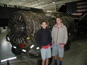 Jake and Paul by a jet engine.