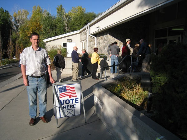 Standing by an early voting line outside the Layton Library.