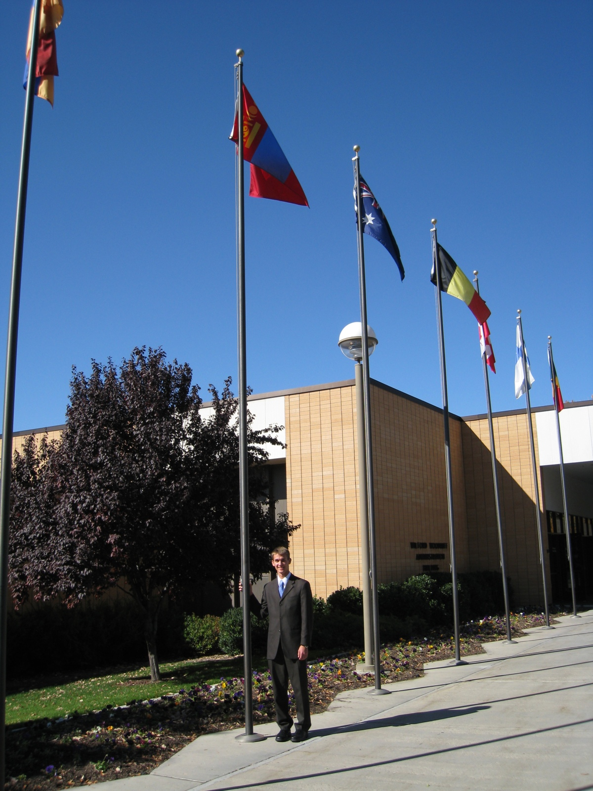 Elder Willoughby by the Mongolian flag on the day he entered the MTC