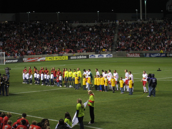 Real Salt Lake and New York Red Bulls before the crowd.