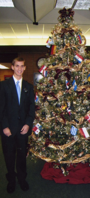Daniel by the MTC Christmas tree.