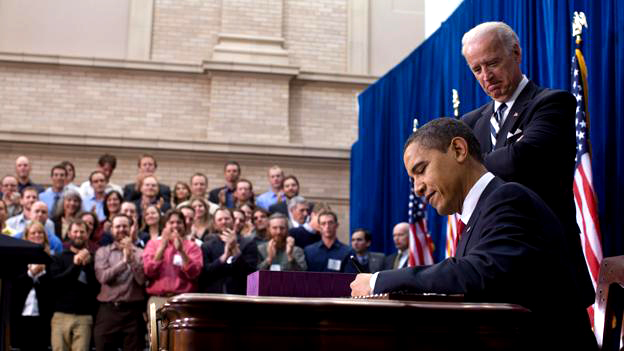 Barack Obama signs American Recovery and Reinvestment Act of 2009