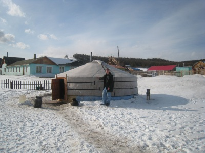 Daniel standing by a ger in Mongolia