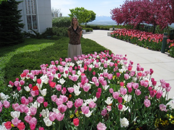 Sarah amongst the flowers at the Bountiful temple