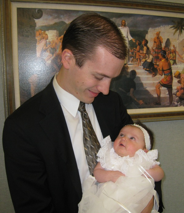 Steven holding Aurora in the church foyer before the blessing