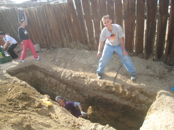 The hole that Daniel helped dig for a part-member family