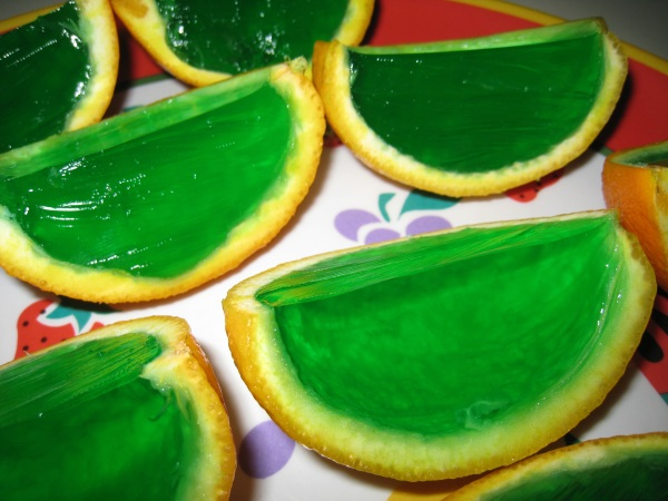 Closeup of the green Jell-O filled orange wedges