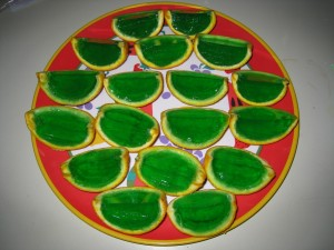 Green Jell-O filled orange wedges