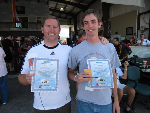 Matt and Jake receive skydiving certificates.