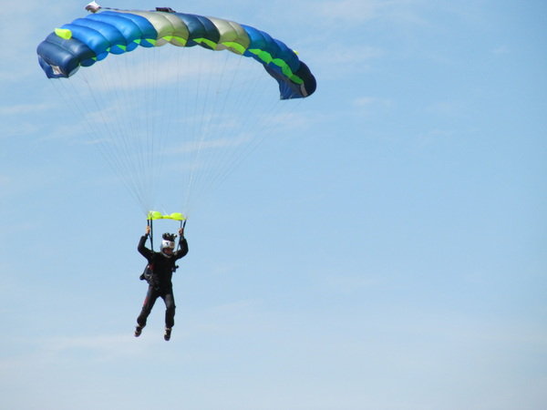 Skydiving photographer comes in first to land.