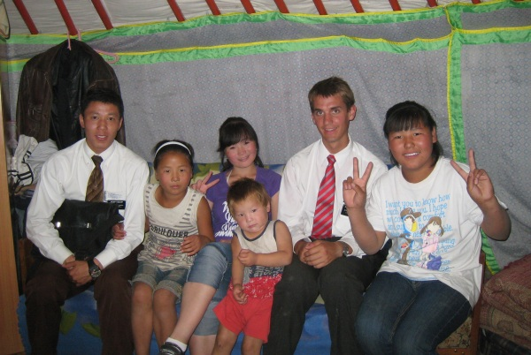 Daniel and his companion with a Mongolian family.