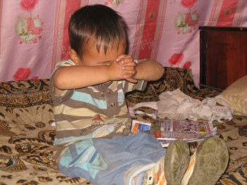 Mongolian child praying.