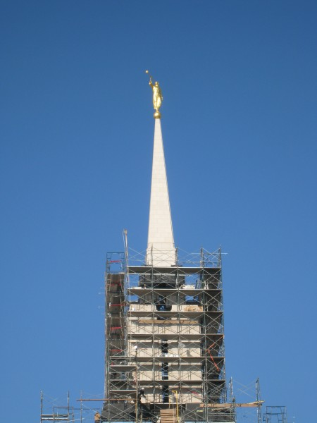 The temple is topped with the traditional gold-leafed angel Moroni statue