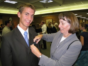 Daniel receives his mission nametag from his mother