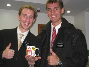 Daniel (right) with Elder Hansen receiving his cup.