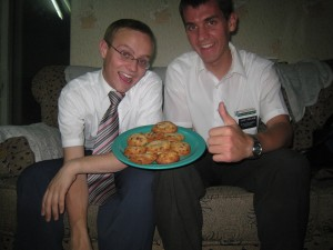 Elder Wright (left) and Daniel with celebratory cookies.