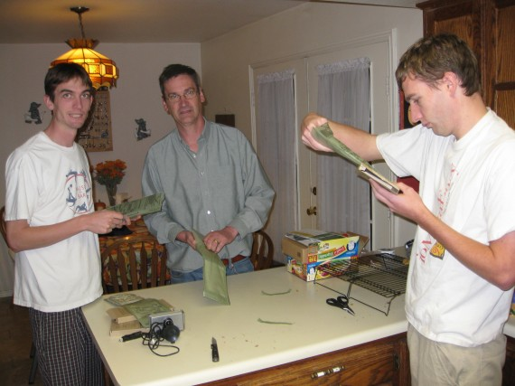 Jake, Rick, and Paul slip the food pouches into the supplied heaters.