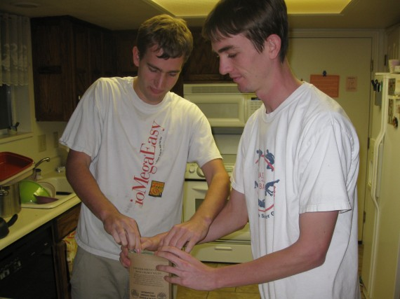 Paul and Jake put the heater and the food pouch back in the box.