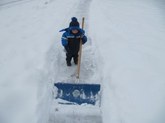 Bryson shoveling snow