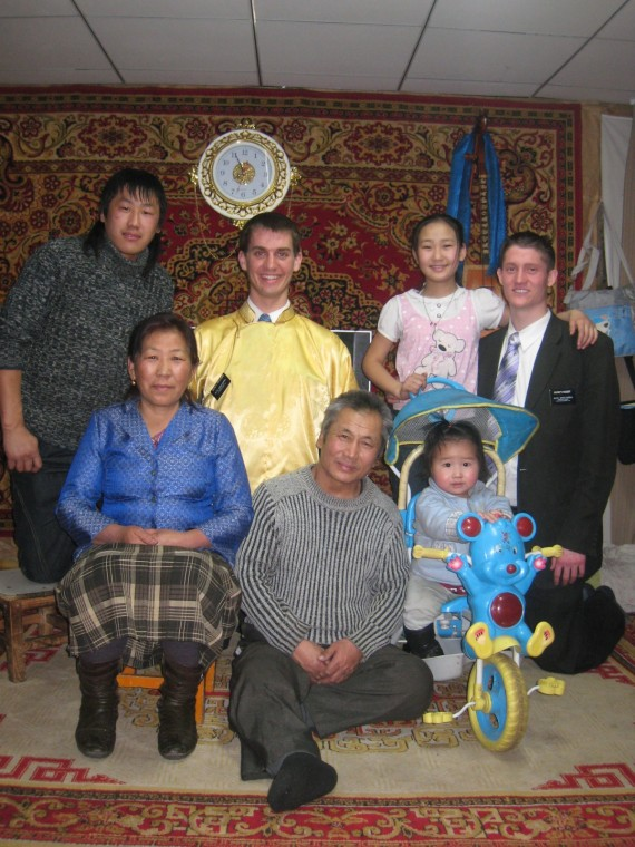 Daniel (wearing yellow shirt) with Mongolian family
