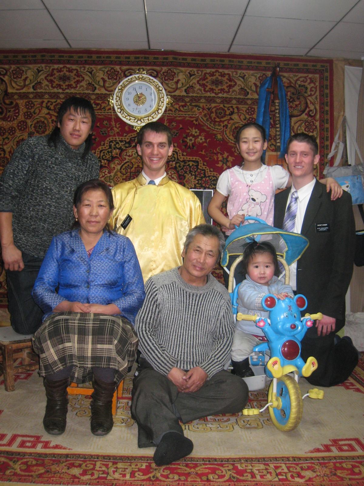 Daniel (wearing yellow shirt) with Mongolian family