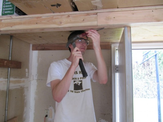 Jake cuts away some of the beam so the door will open
