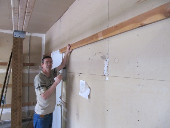 Rick installing the 2x4 shelf support