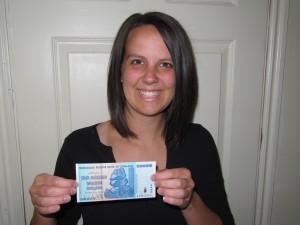 Rachel holding Zimbabwe banknote