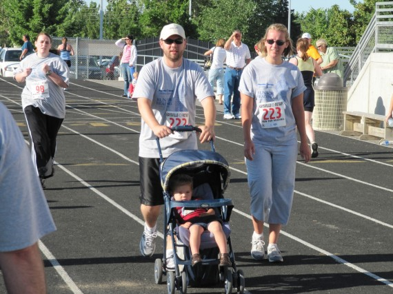Derek, Sarah, and Bryson at the finish