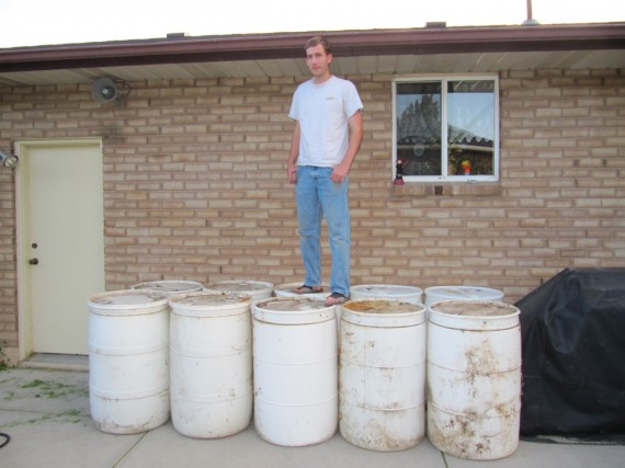 Paul standing on ten barrels