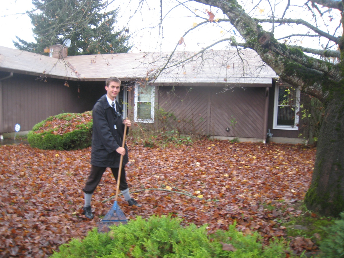 Daniel raking leaves