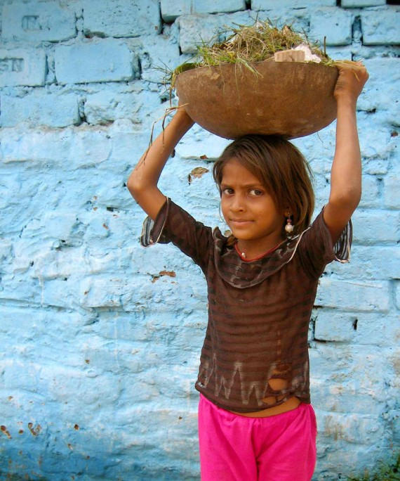 Girl clearing rubble at Kochrab, India