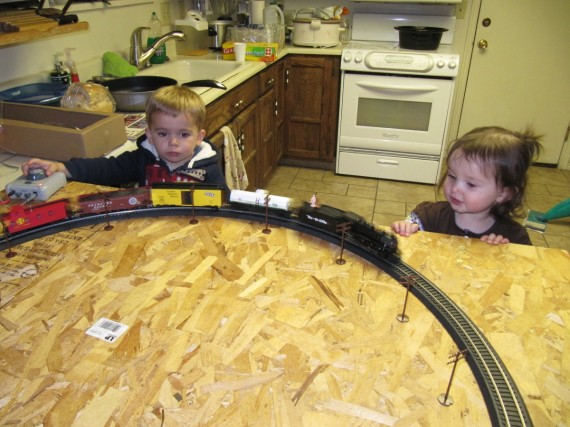 Bryson and Aurura admire the train set