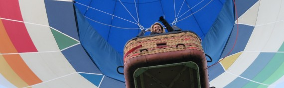 Hot Air Balloon Passenger Waves Goodbye