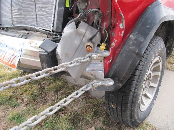 A chain is attached to the Jeep bumper