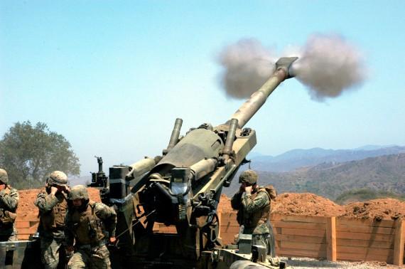 Firing a M-198 howitzer